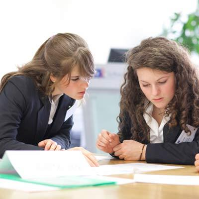 Two female school students studying