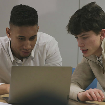 Two-male-students-on-laptop