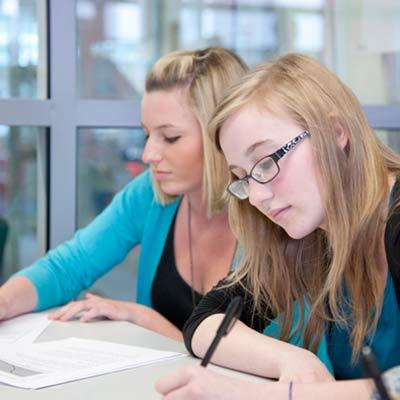 Two-young-female-students-studying