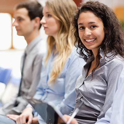 Young-women-listening-to-presentation