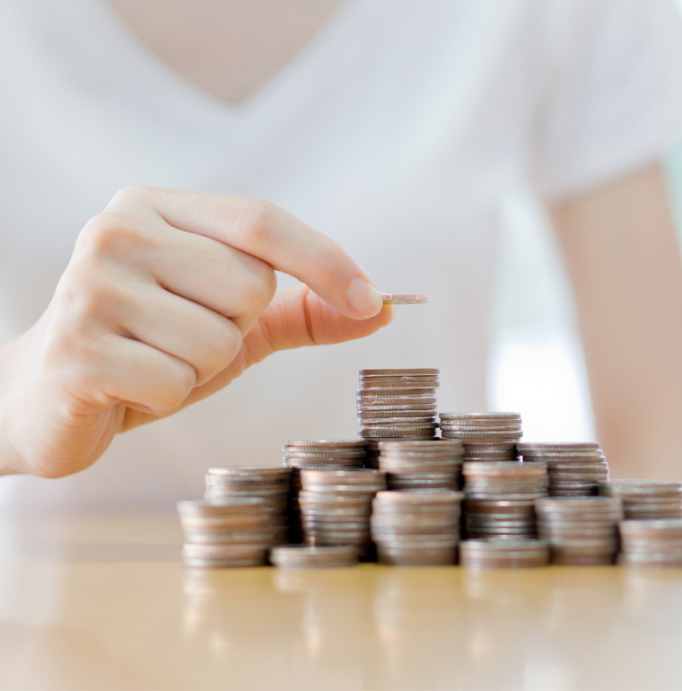 Business woman counting coins