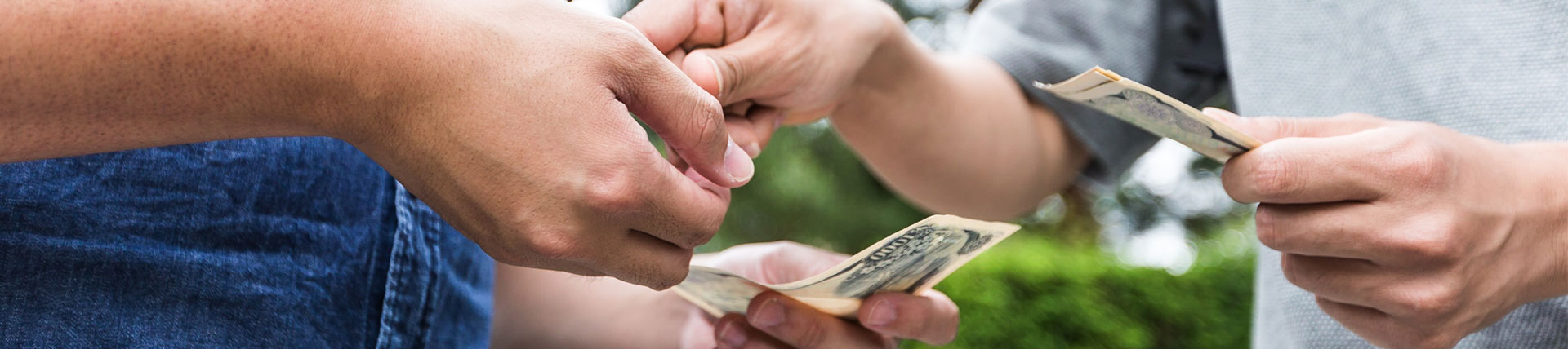 Two people exchanging money notes