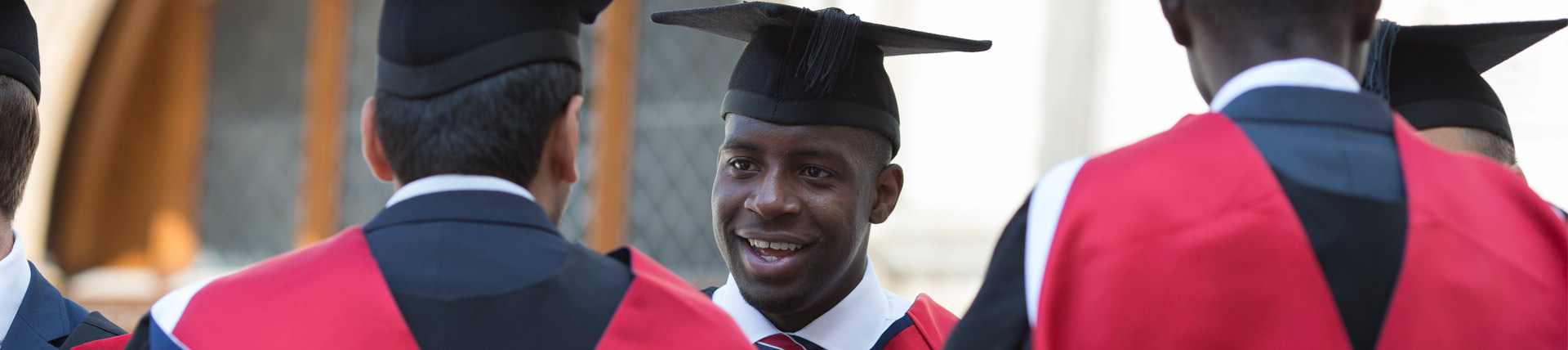 Man wearing a graduation hat and gown