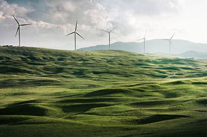 Wind turbines on a green hill