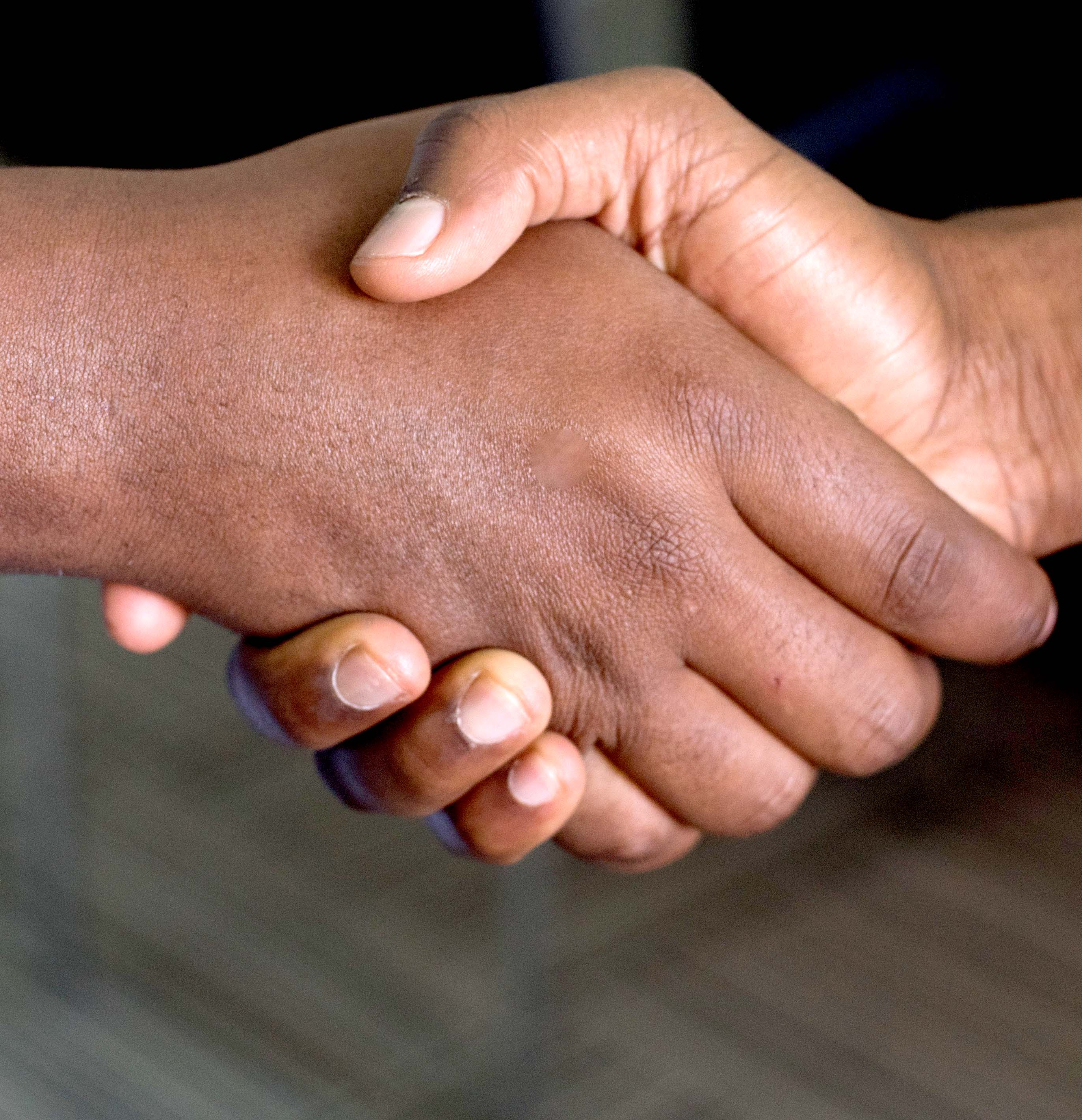 Close up of a handshake