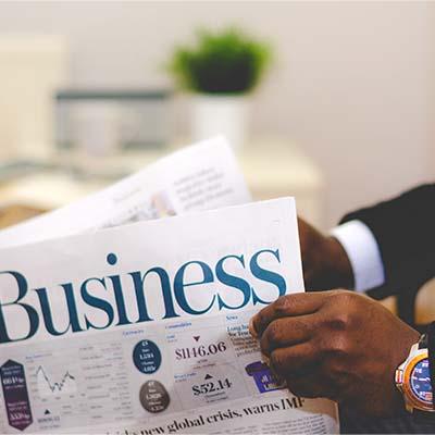 Man reading business news