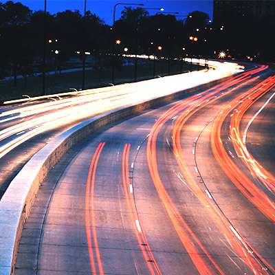 Car lights on a winding road
