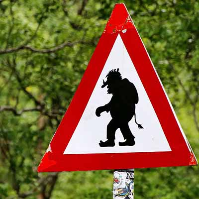 Road sign warning of troll