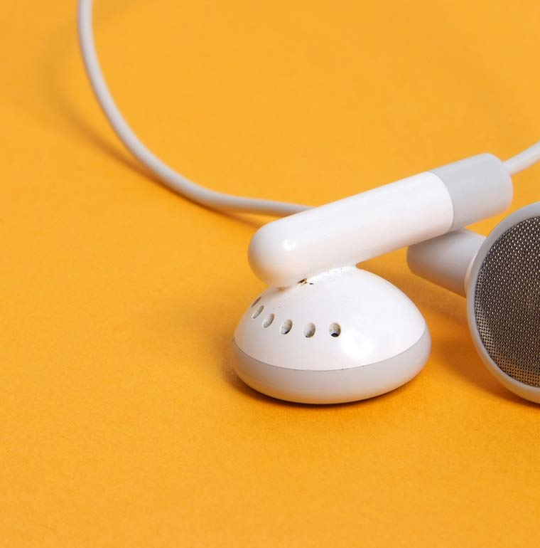 white-headphones-on-an-orange-background
