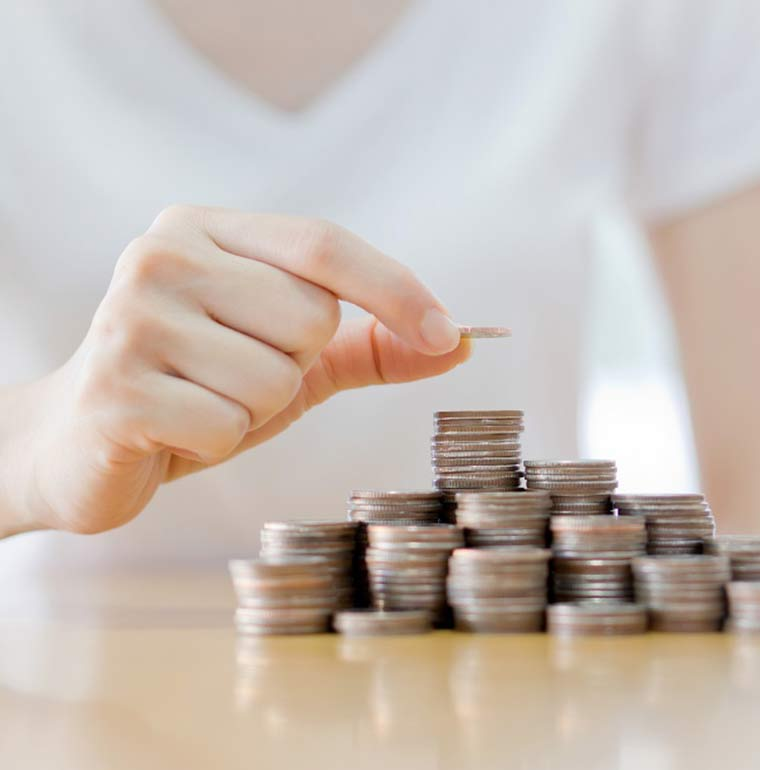 Women-stacking-coins-in-piles