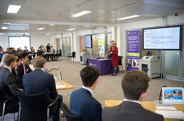 Students gear up to start the first challenge at the Student Investor Challenge final, held in the City of London