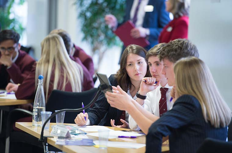 The Student Investor Challenge competition is designed to improve students' understanding of investing and finance. Here, students from the Yarm School work during the Student Investor Challenge final