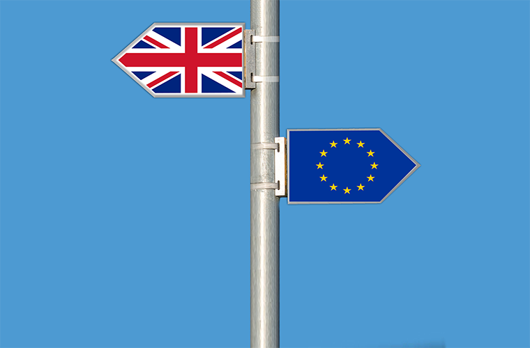 EU flag and British flag on signpost
