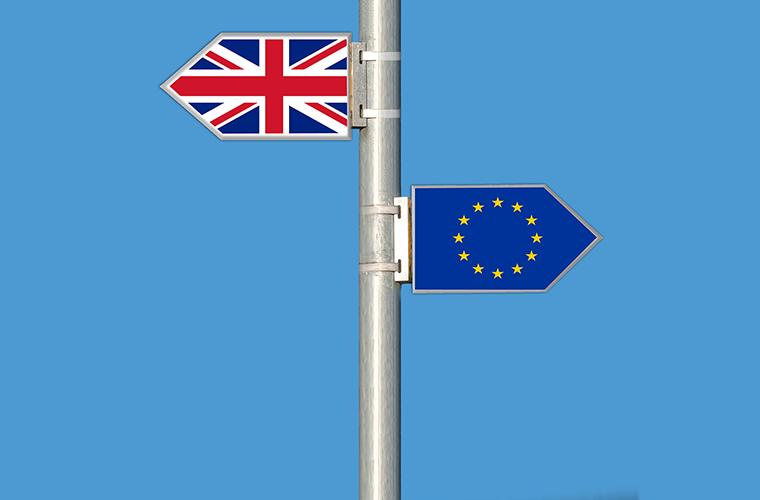 EU flag and British flag on signpost