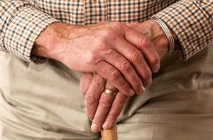hands-walking-stick-older-person