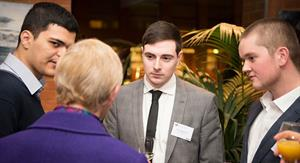Students networking at an event