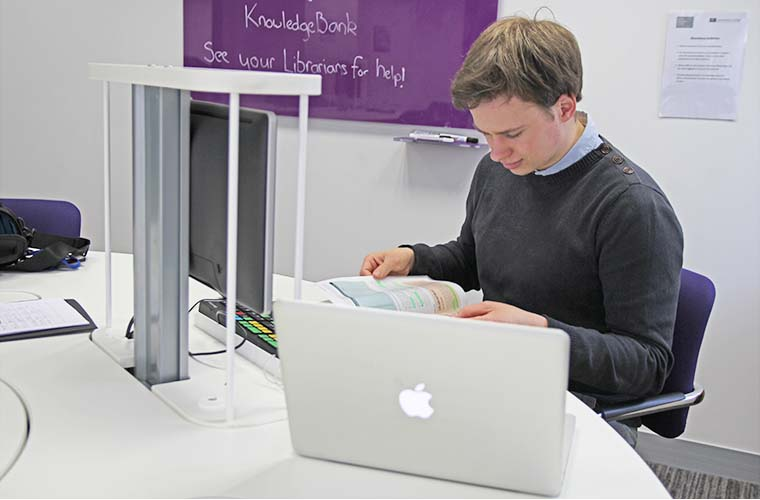 Mads Brinkmann Andersen working in the Henry Grunfeld library